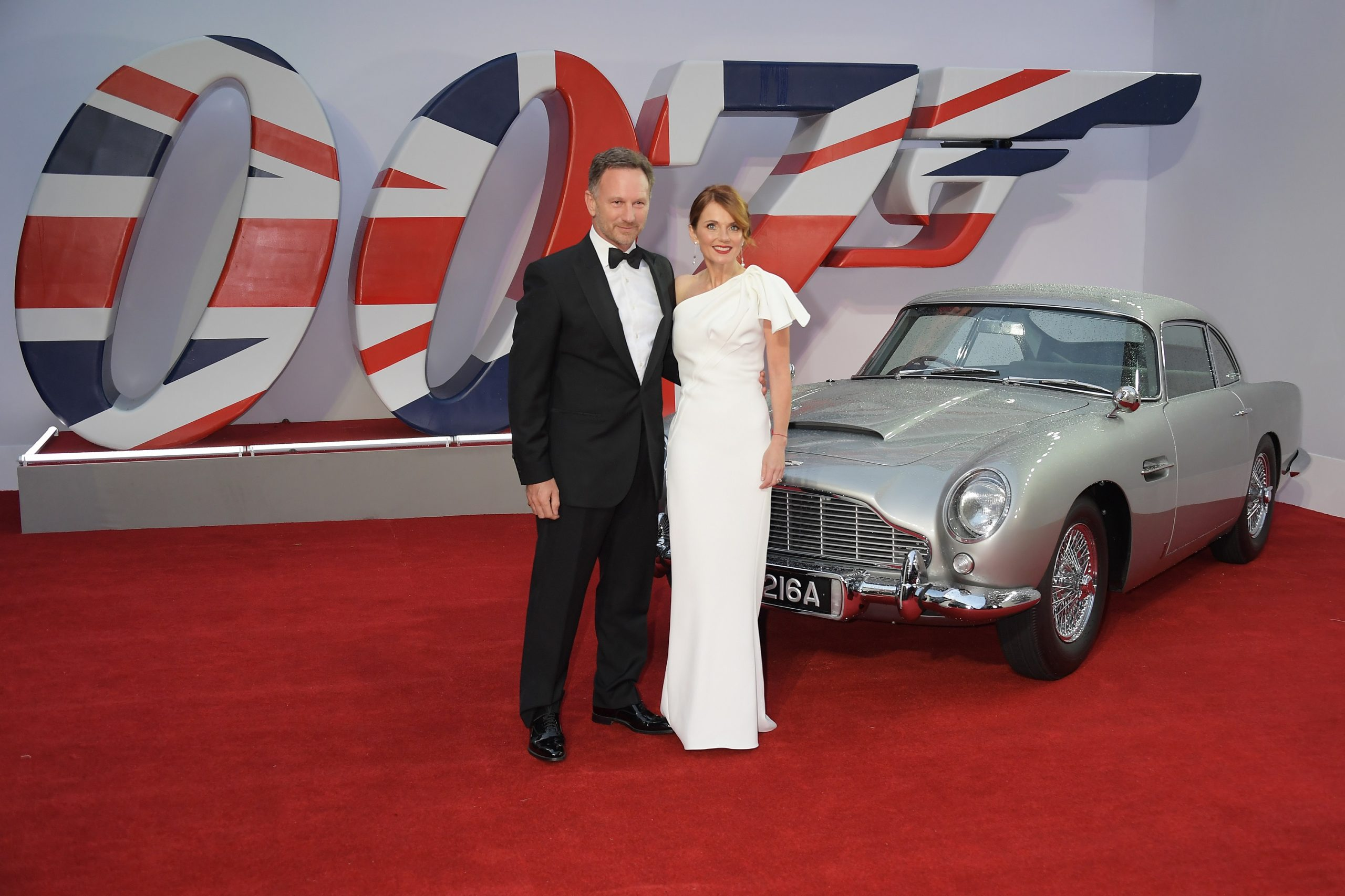 """Christian and Geri Horner at the """"No Time to Die"""" premier, with an Aston Martin DB5 in the background"""