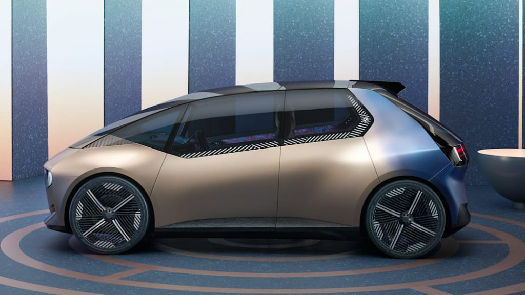 A BMW iVision Circular concept, rendered on a showroom floor