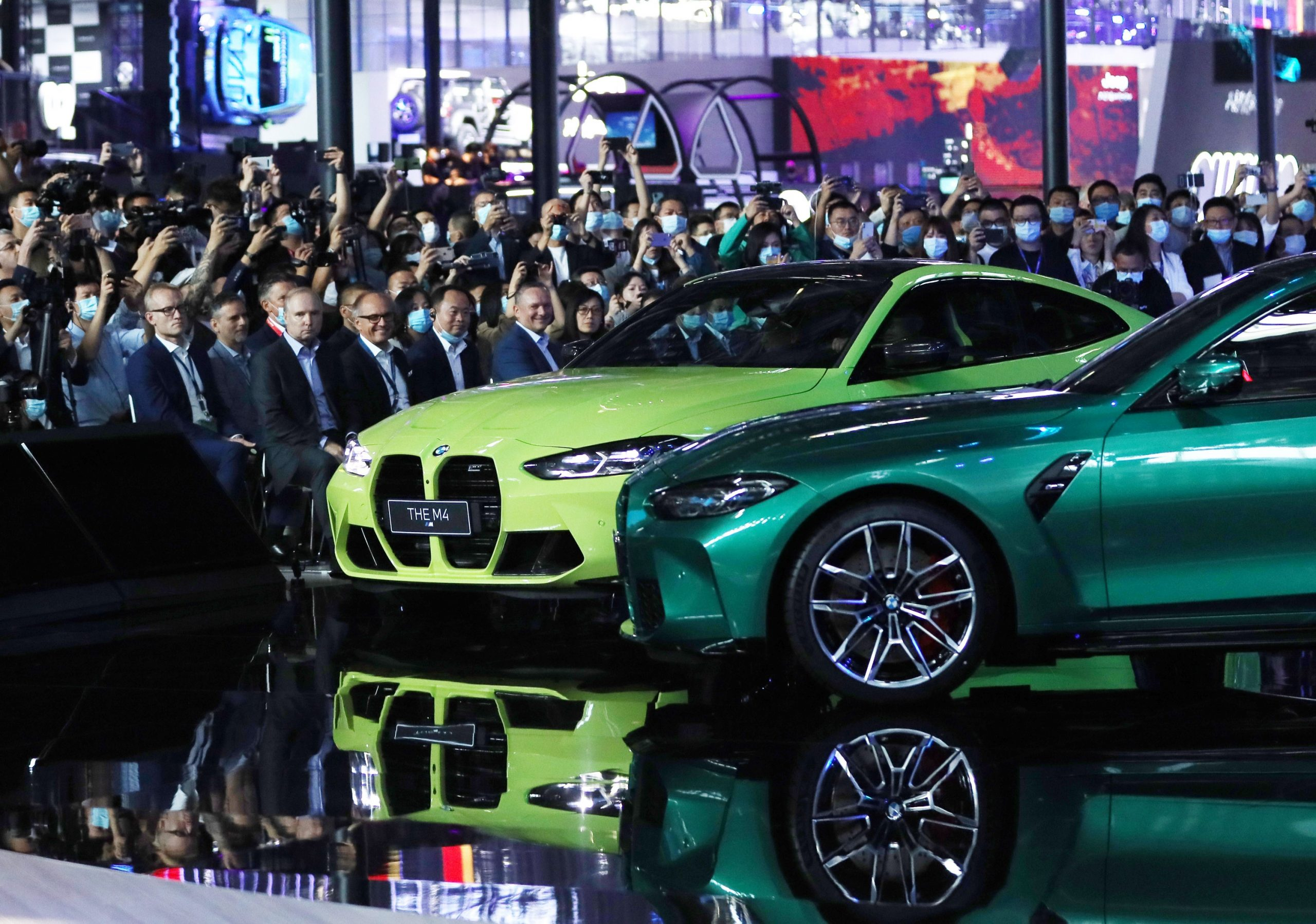A pair of BMW M3 and M4 sports cars sporting the iconic BMW kidney grille at their debut in China, shot from the front 1/4 angle