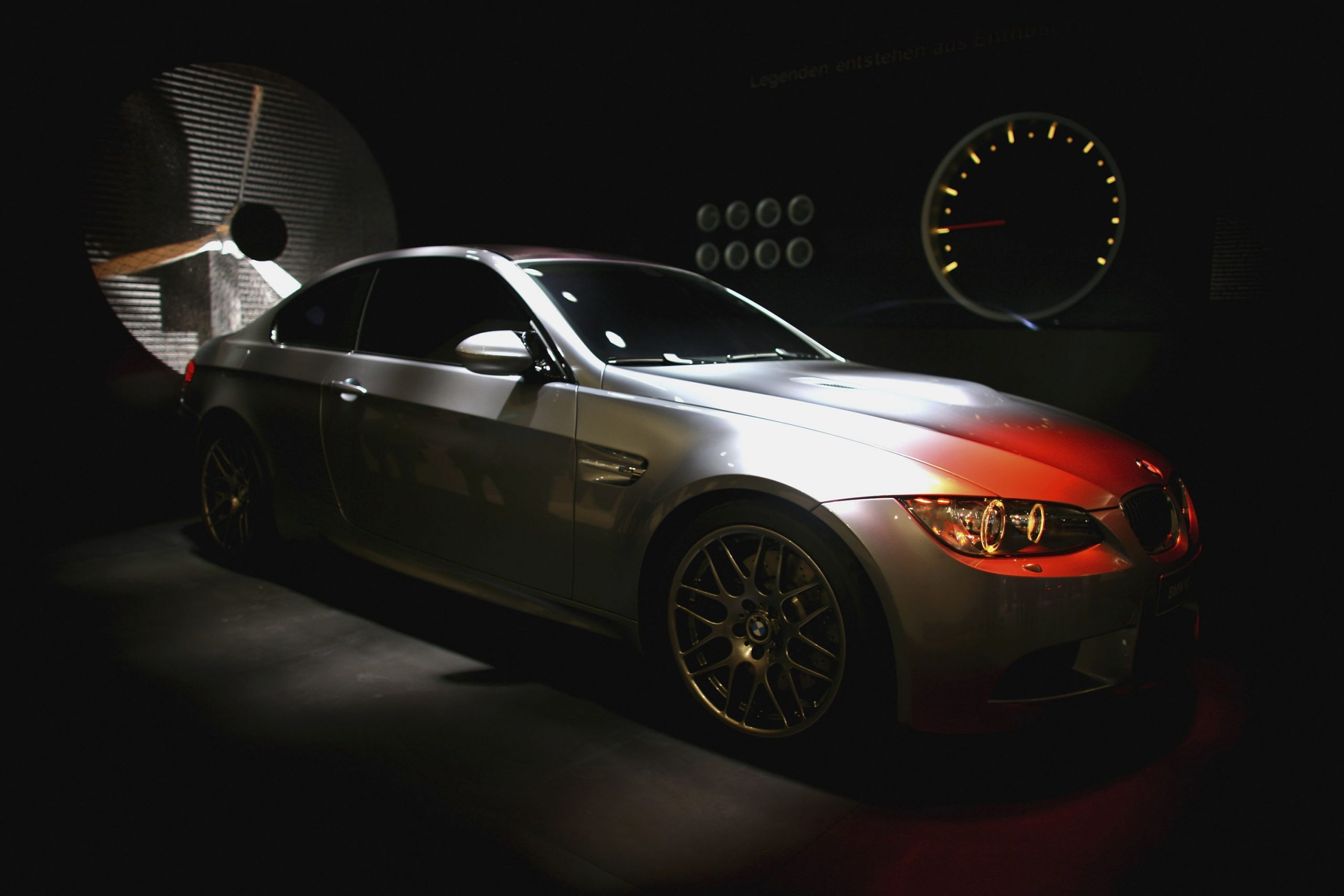 A silver E92 generation BMW M3 shot in the shadows from the front 3/4