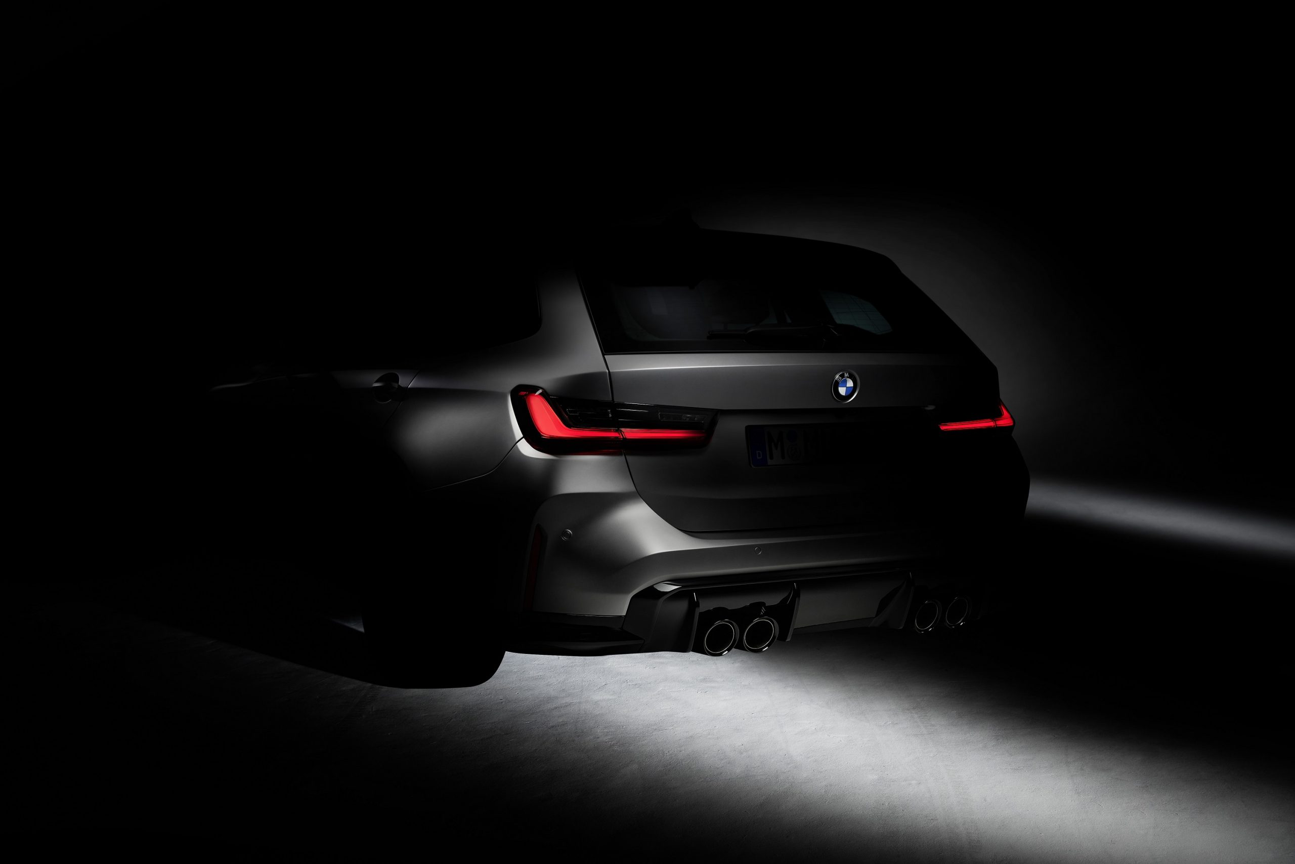 The silhouette of the 2022 BMW M3 touring shot from the rear 3/4 angle