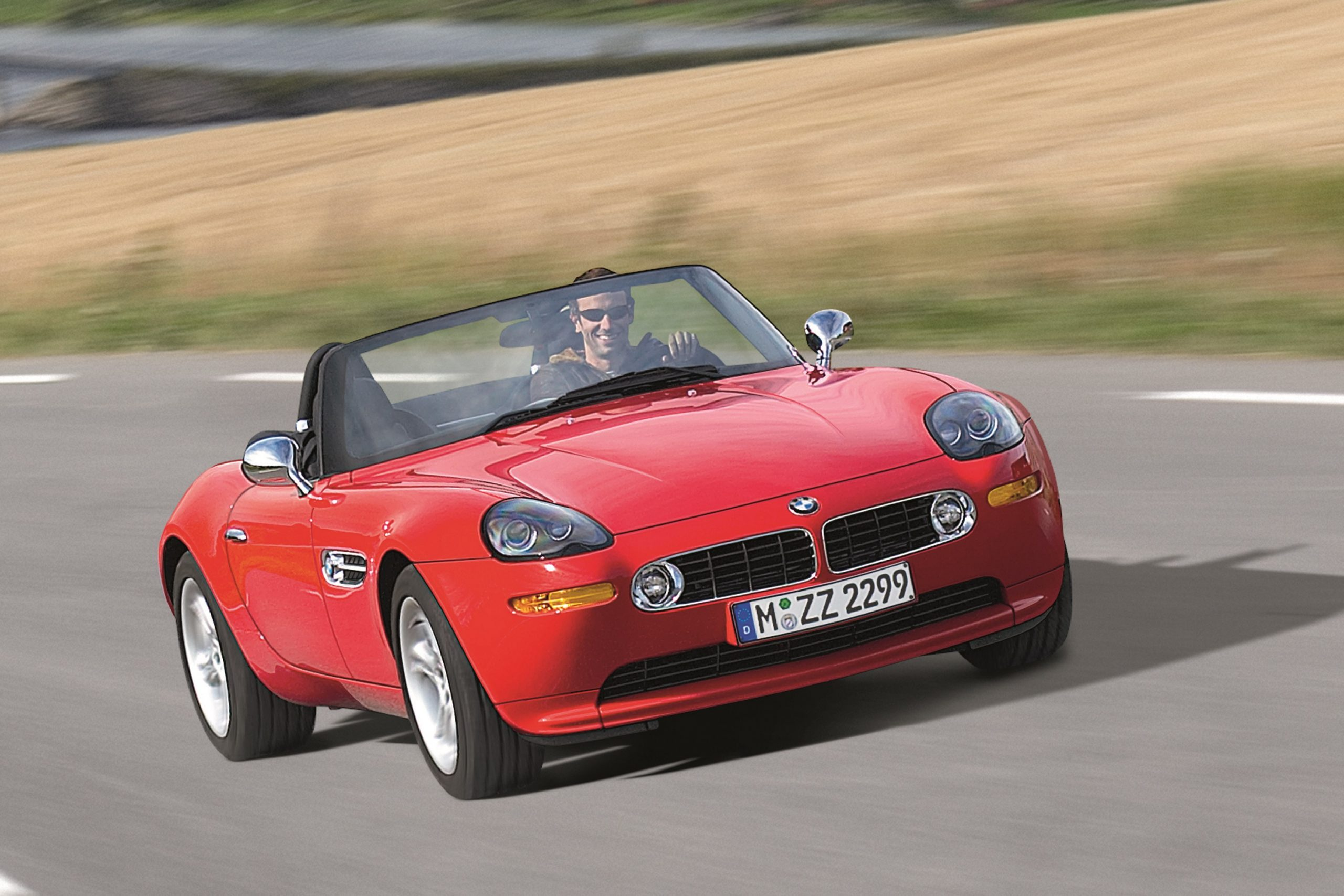 A red BMW Z8 convertible shot in motion from the front