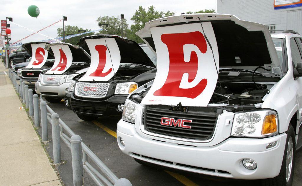GMC SUVs at a car dealership in Michigan
