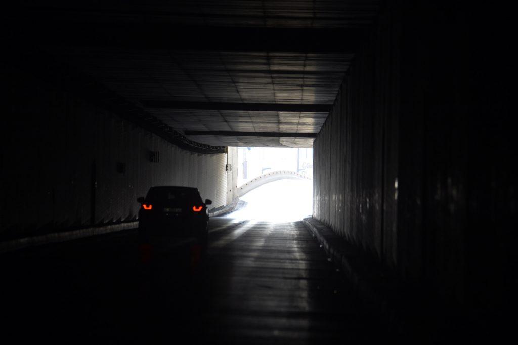 A car passes through a tunnel