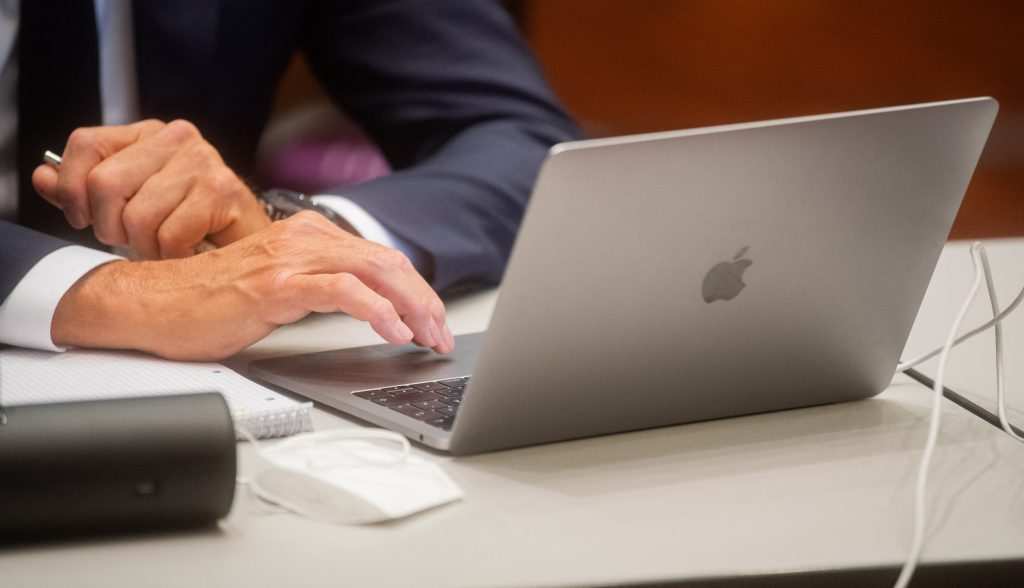 One of four former Volkswagen (VW) executives uses his laptop