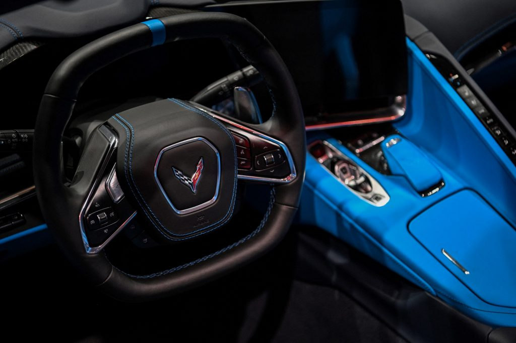 The blue leather interior of a 2020 Corvette at an auto show