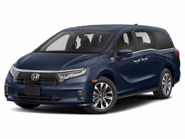 A navy blue 2021 Honda Odyssey against a white background.