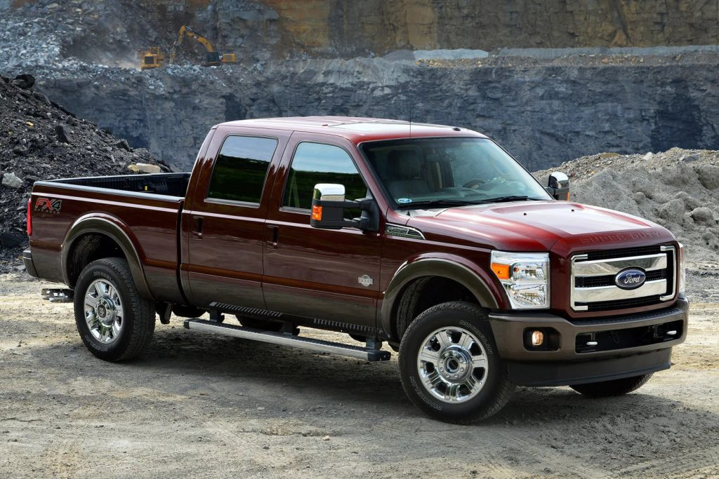 A brown 2015 F250 Super Duty parked on a cliff - one of the best used pick up trucks under $20,000