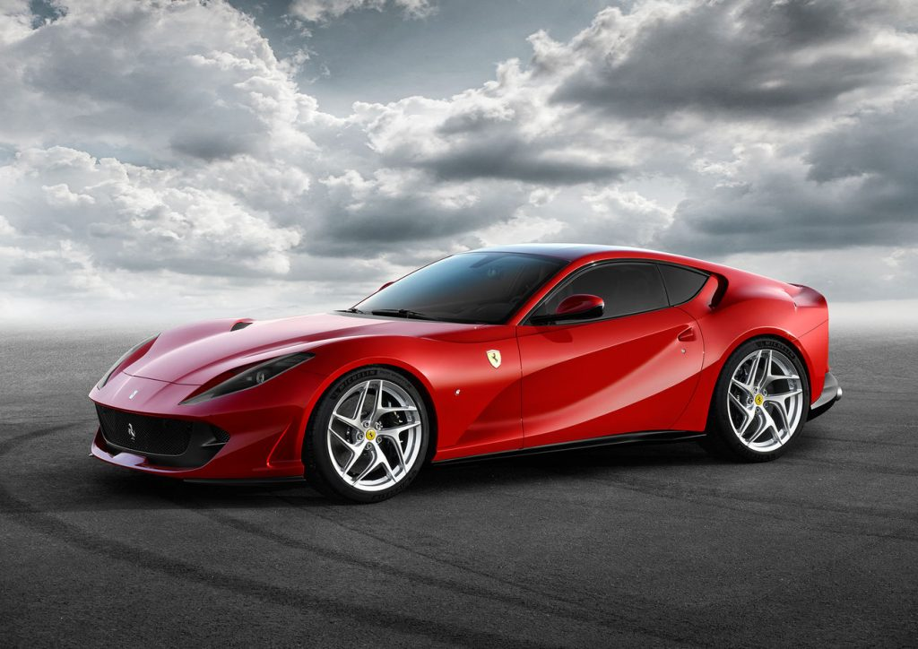 A red Ferrari 812 Superfast shot from the front 3/4 angle