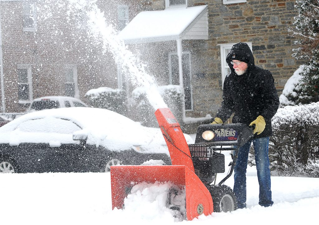 Jeff Bowers clears the sidewalk in front of his Ridley Park home Tuesday morning. Bowers, who has lived in Ridley Park his entire life said his street is always among the last to be plowed.