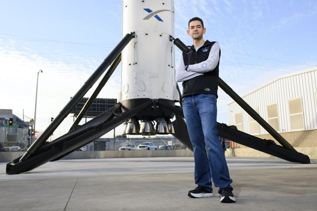 Inspiration4 mission commander Jared Isaacman, founder and chief executive officer of Shift4 Payments, stands for a portrait in front of the recovered first stage of a Falcon 9 rocket at Space Exploration Technologies Corp.
