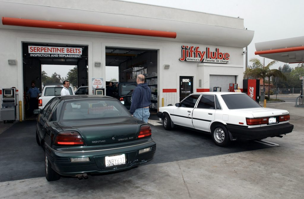 Cars line up for an oil change at a jiffy lube business