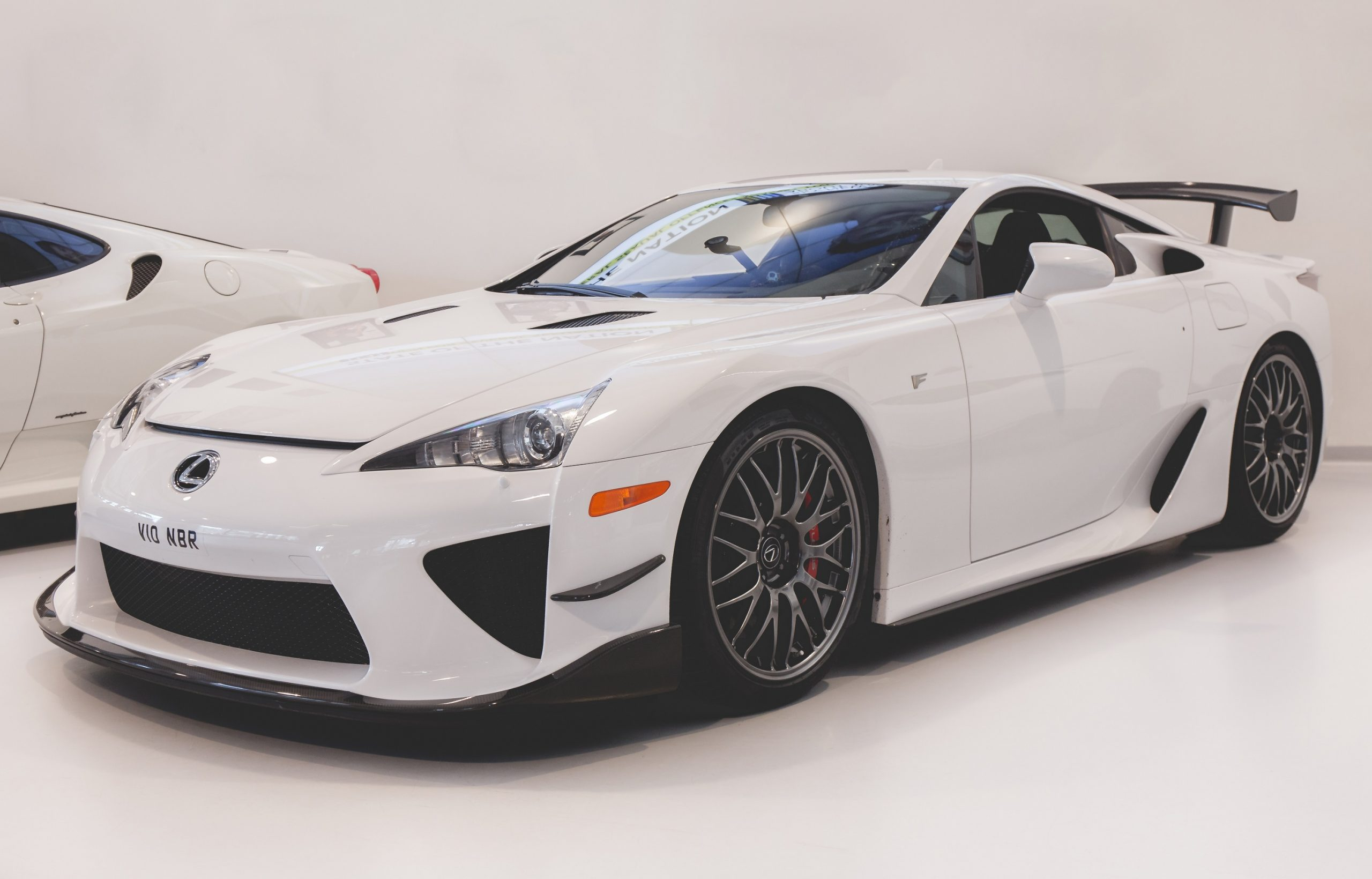 A white Lexus LFA Nurburgring edition shot from the front 3/4 angle