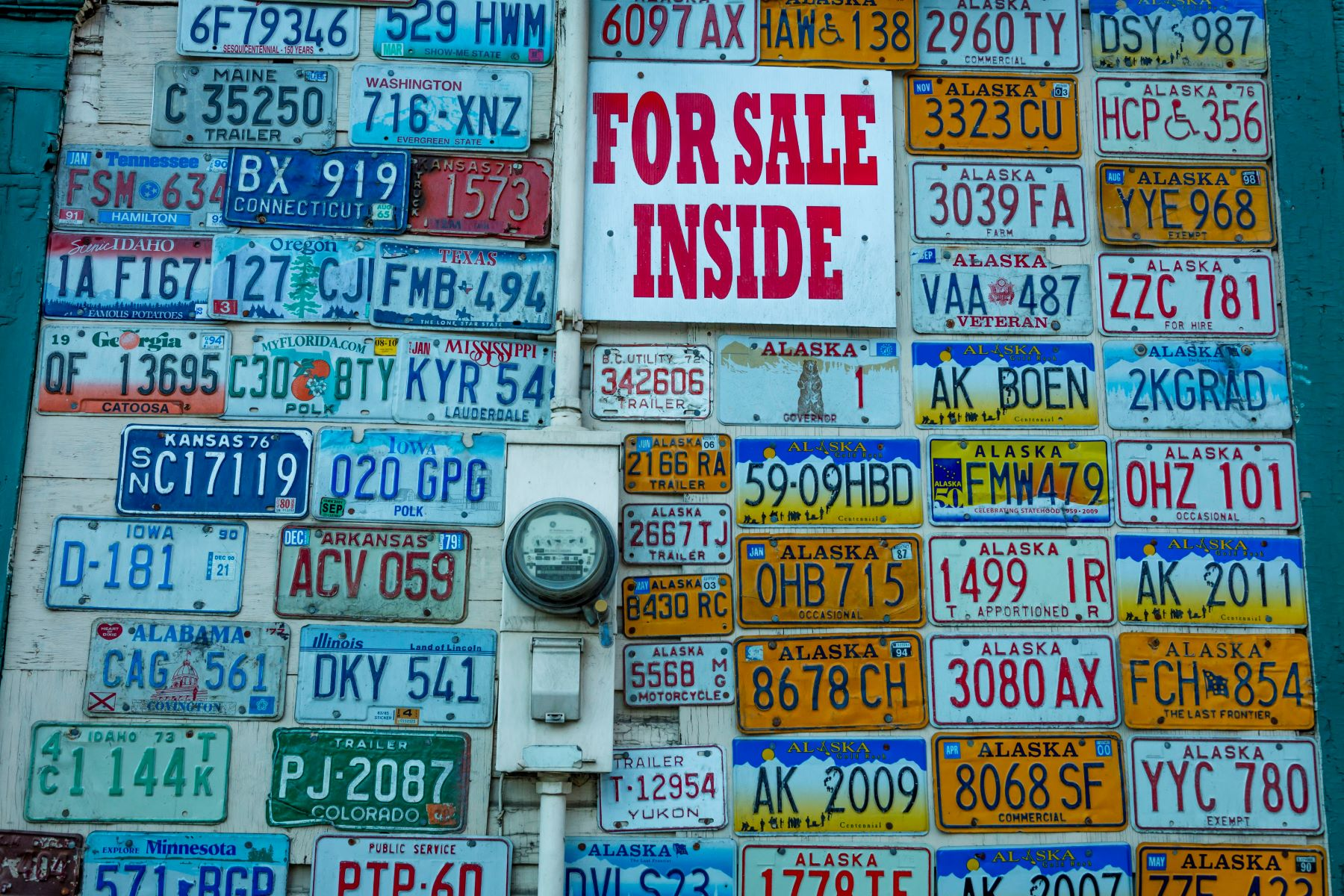 A wall of old license plates on a gift shop in Fairbanks, Alaska
