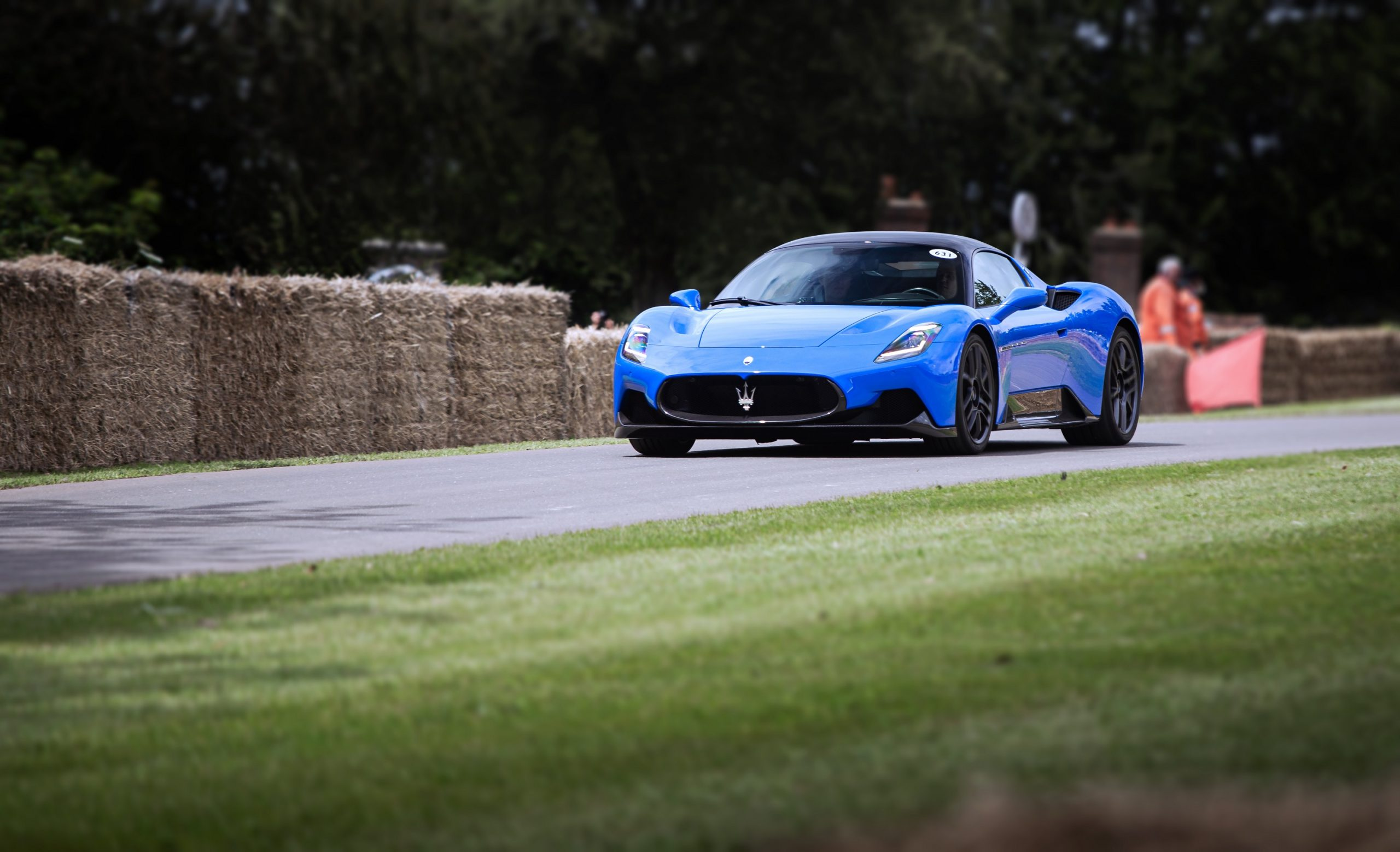 A blue Maserati MC20 shot from the front 3/4 at the Goodwood Festival of Speed