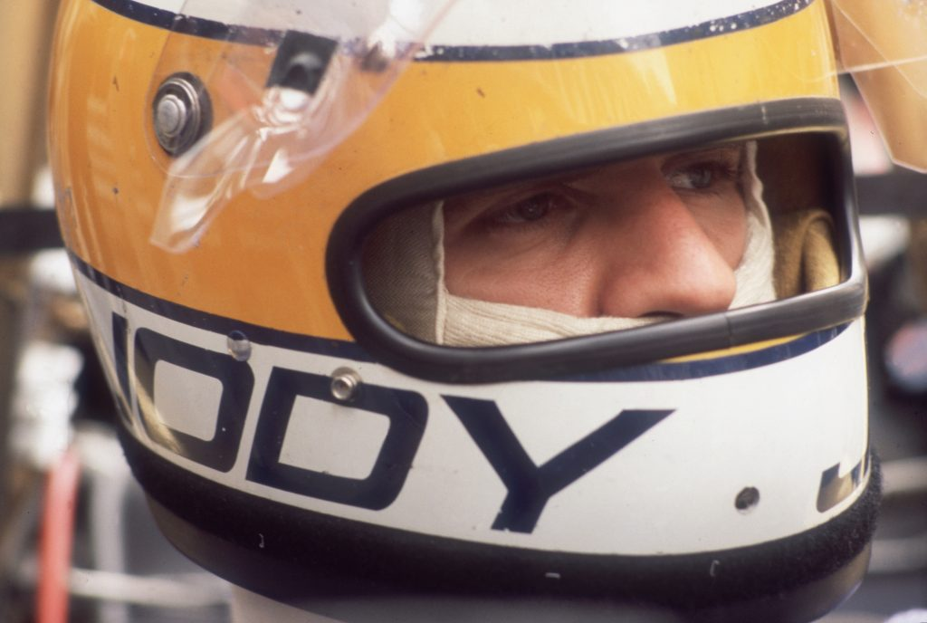 South African racer Jody Scheckter wears a motorcycle helmet after he won the Monaco Grand Prix in May 1977