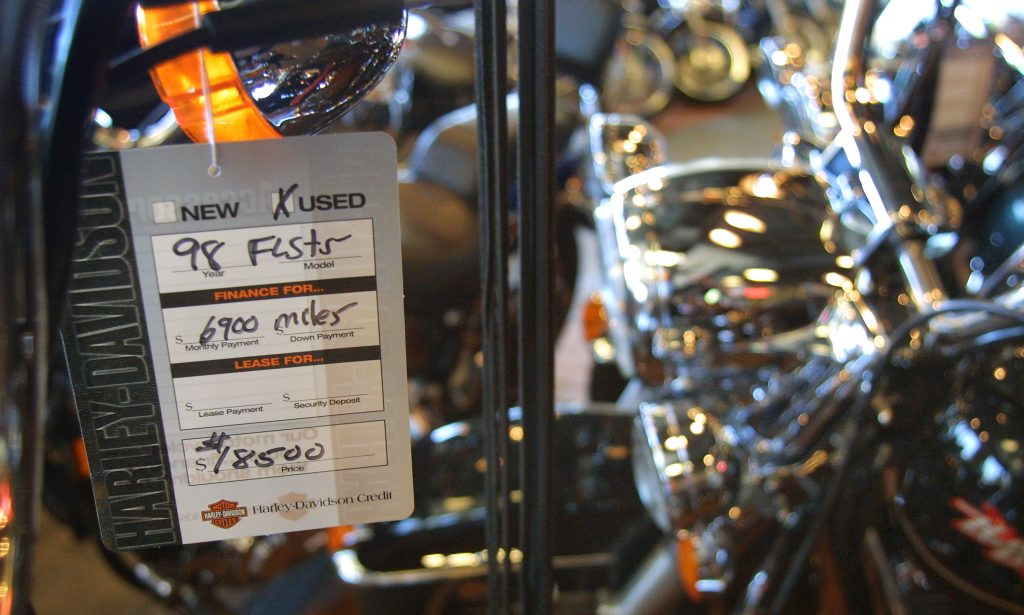 A used Harley-Davidson motorcycle for sale with an $18,500 price tag is displayed on June 26, 2001