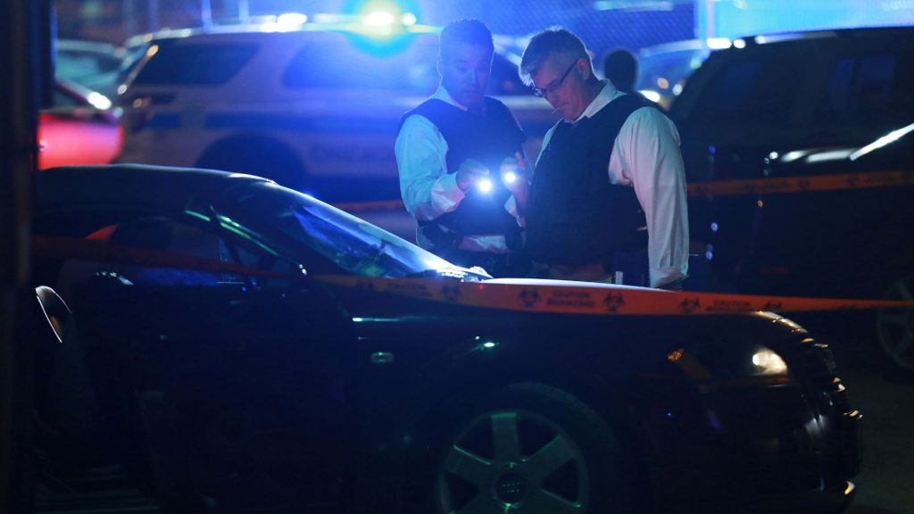 Police detectives investigating Archer Avenue in Chicago after a shooting