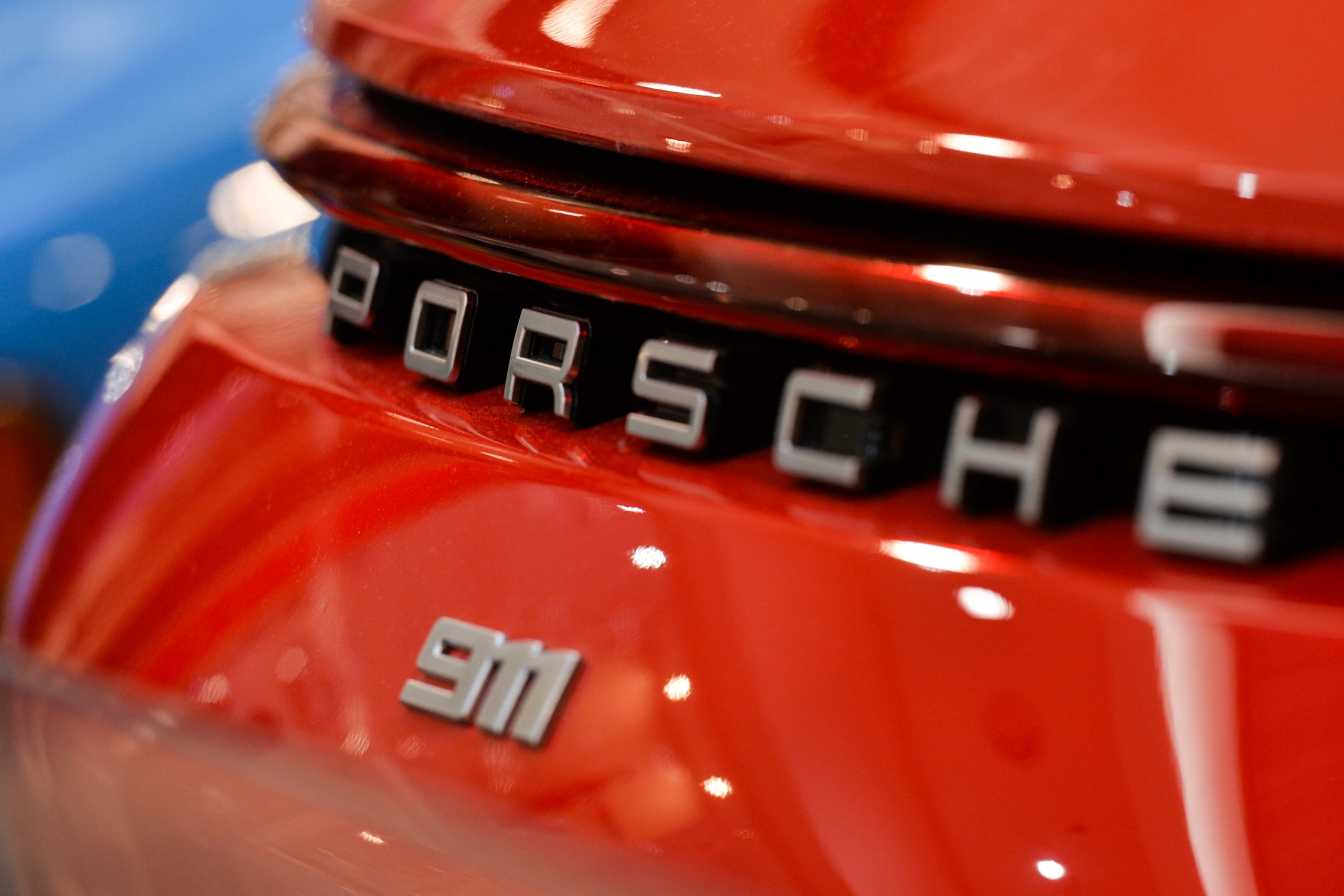 The rear 911 badge on a red Porsche