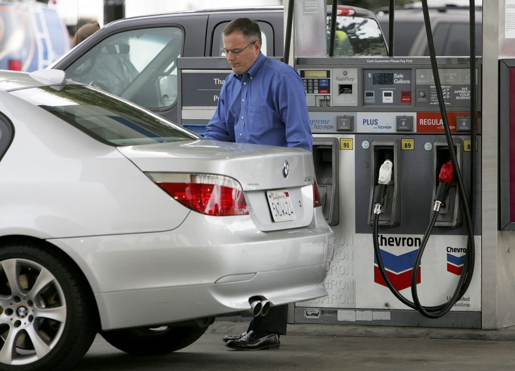 A customer pumps premium gas into a BMW at a Chevron station in April 2006 in San Francisco