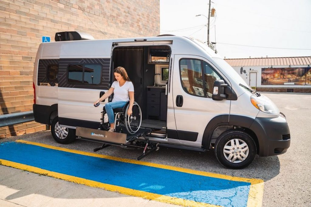 a woman using the lift in the new wheelchair accessible Winnebago Roam
