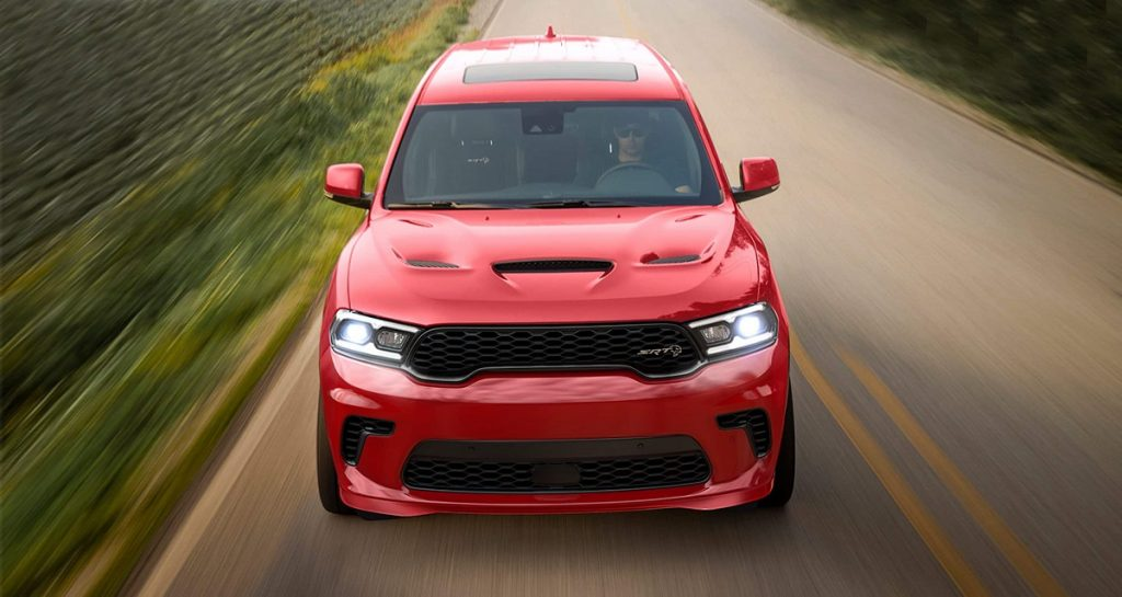 A red 2021 Dodge Durango flying down the highway.