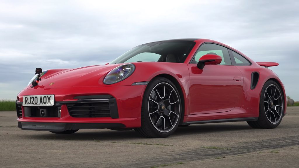 Red 2021 Porsche 911 Turbo S preparing for a drag race