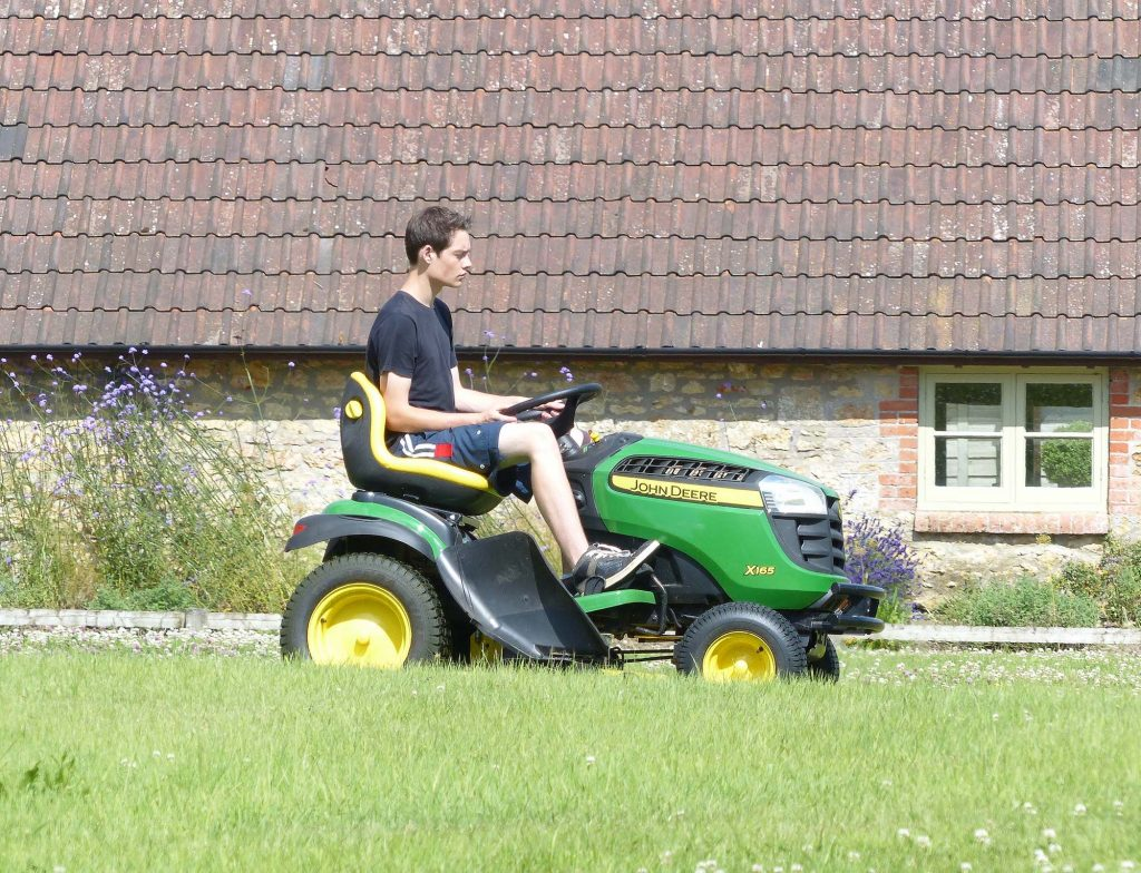 Young Man Mowing the Lawn