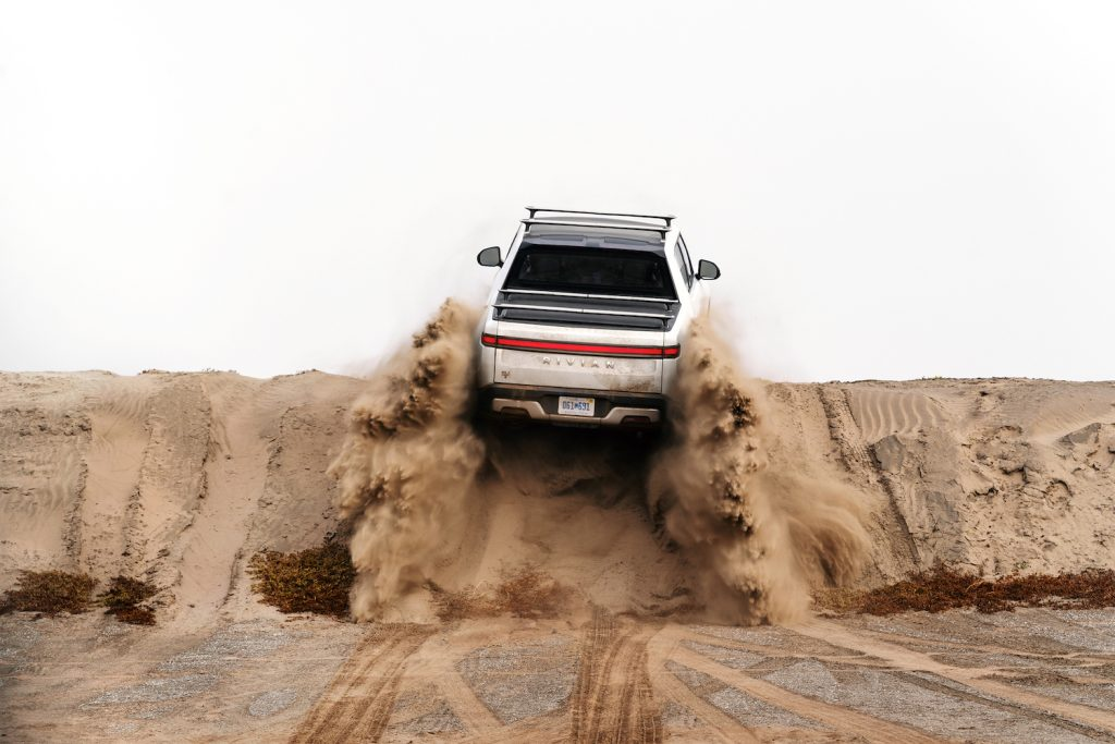 This is a press photo of a pre-production Rivian R1T off-roading. Watch Motor Trend's Rivian R1T Electric Truck Review.