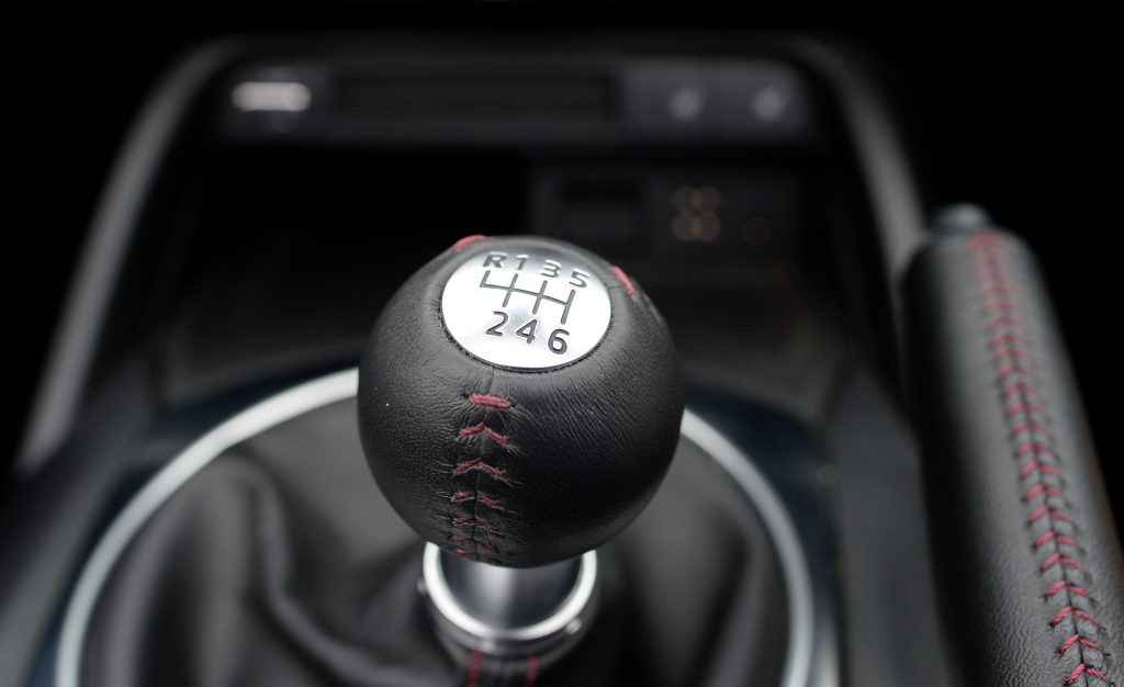 Leather-wrapped 6-speed manual transmission gear shifter on the 2017 Mazda MX-5 Miata Retractable Fastback edition.