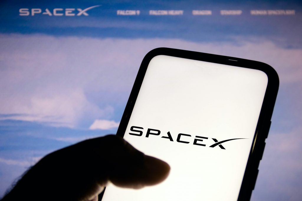 In this photo illustration, a Space Exploration Technologies (SpaceX) logo seen displayed on a smartphone.