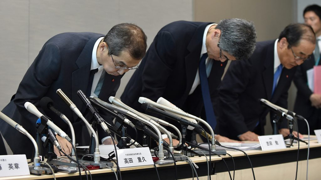 Executives from Takata Corp apologizing during a press conference after the airbag recall