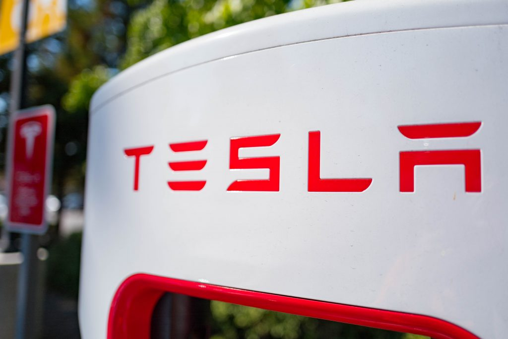 Close up of Tesla logo on a charger at a Supercharger rapid battery charging station