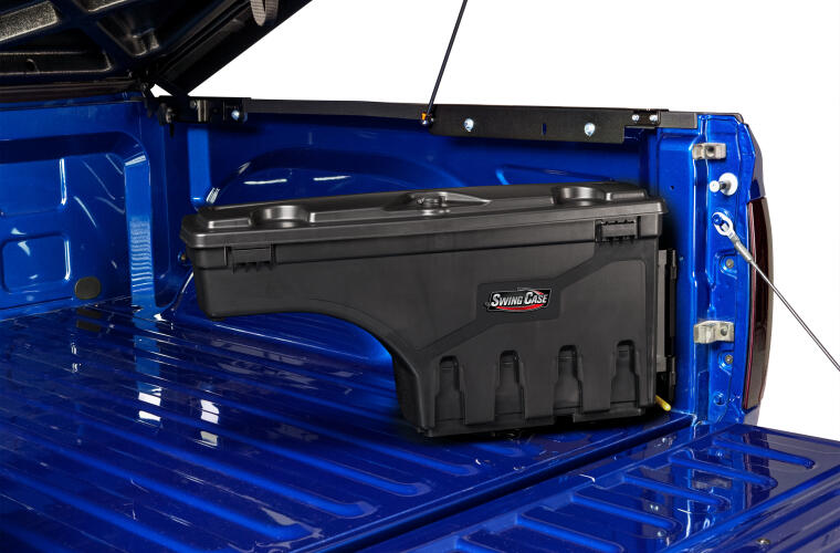 An undercover swingcase bed storage container inside the bed of an F-150
