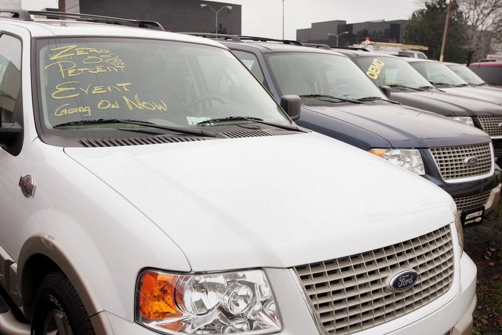Used Ford SUVs sit on a dealer lot.