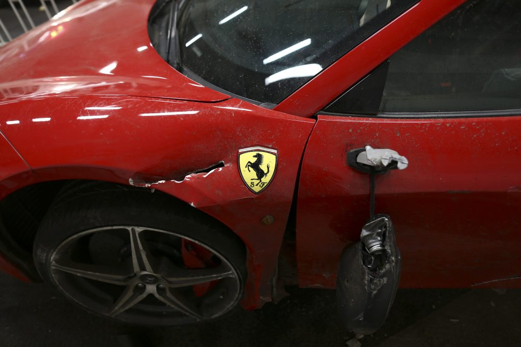 View of a damaged Ferrari after collision