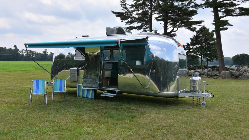 Vintage Airstream camper with awning up