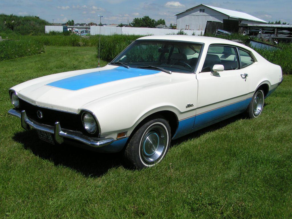 A white and blue 1972 Ford Maverick sedan