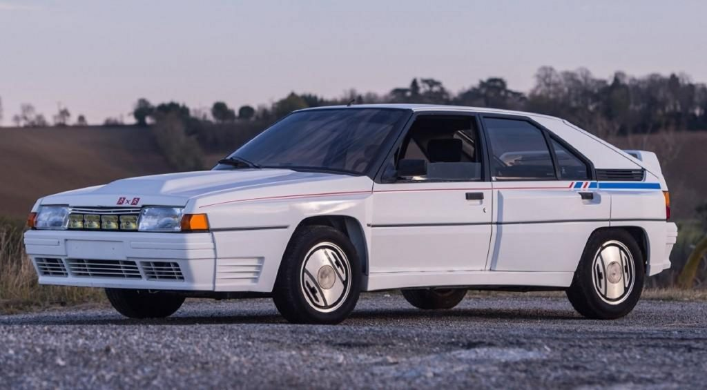 A white-with-blue-and-red-stripes 1986 Citroen BX 4TC Competition