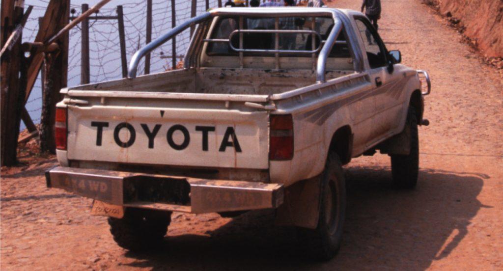 A white Toyota Pickup truck.