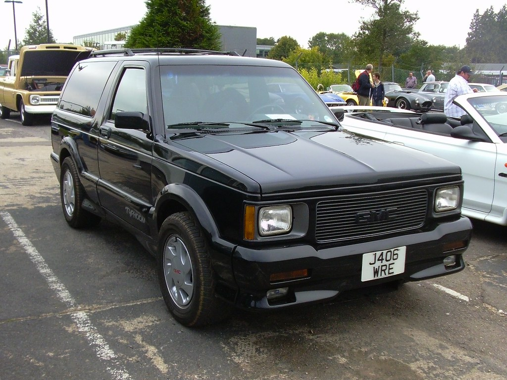 A black 1992 GMC Typhoon parked outside in a parking lot