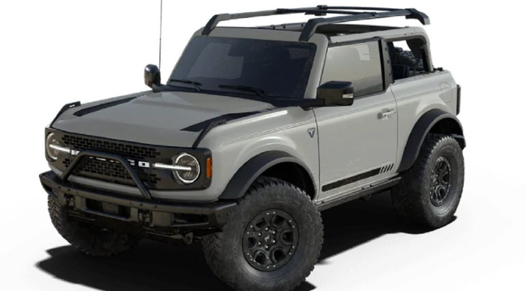 A taupe 2021 Ford Bronco First Edition against a white background.