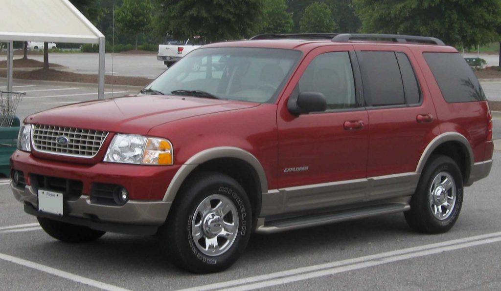 A red 2002 Ford Explorer parked in a parking lot