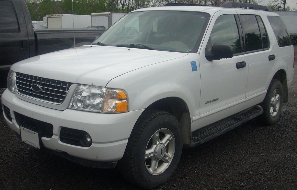 A white 2005 Ford Explorer parked in a parking lot