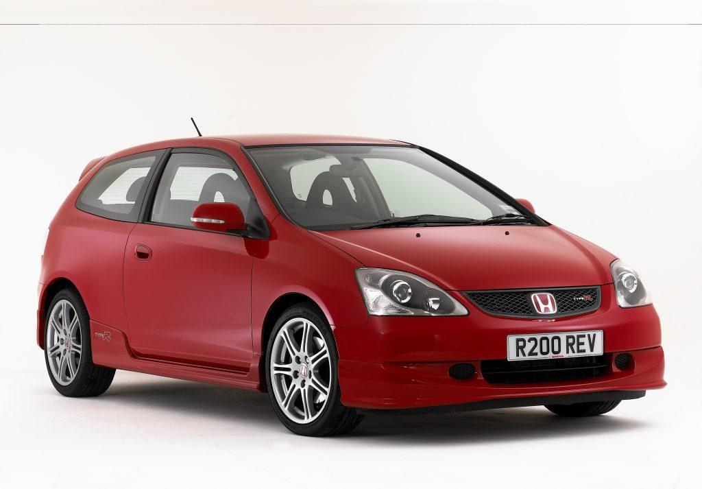 A red 2005 Honda Civic Type R, shot from the front 3/4 against a white studio background