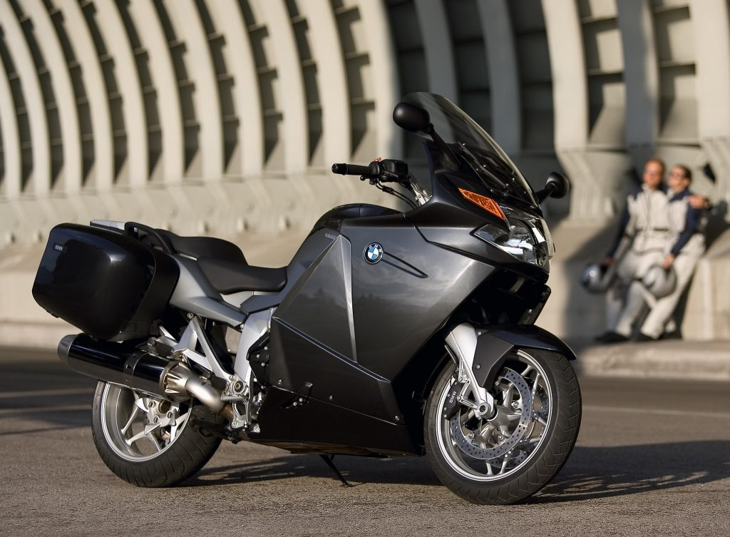 A gray-and-black 2006 BMW K 1200 GT next to a concrete structure