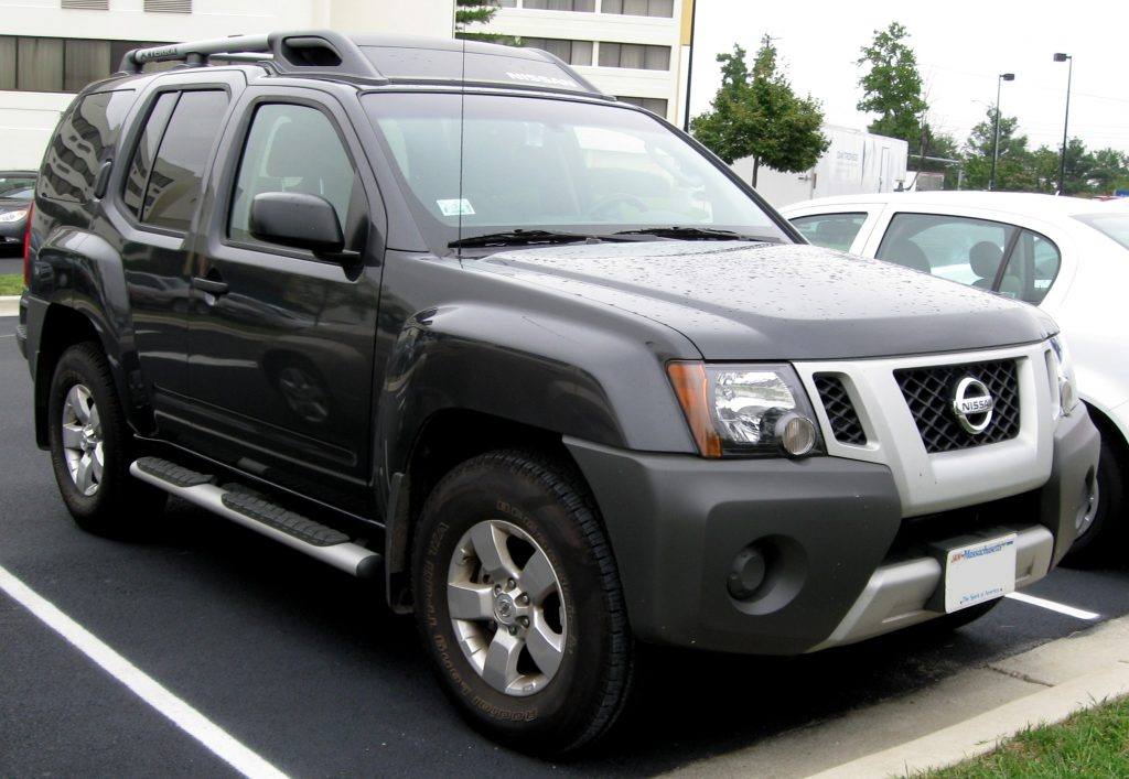 A discontinued black 2009 Nissan Xterra parked in a parking lot