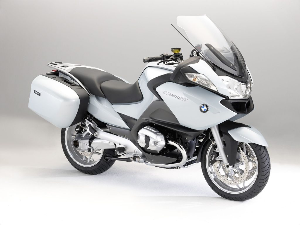A white-and-black 2010 BMW R 1200 RT sport-touring bike