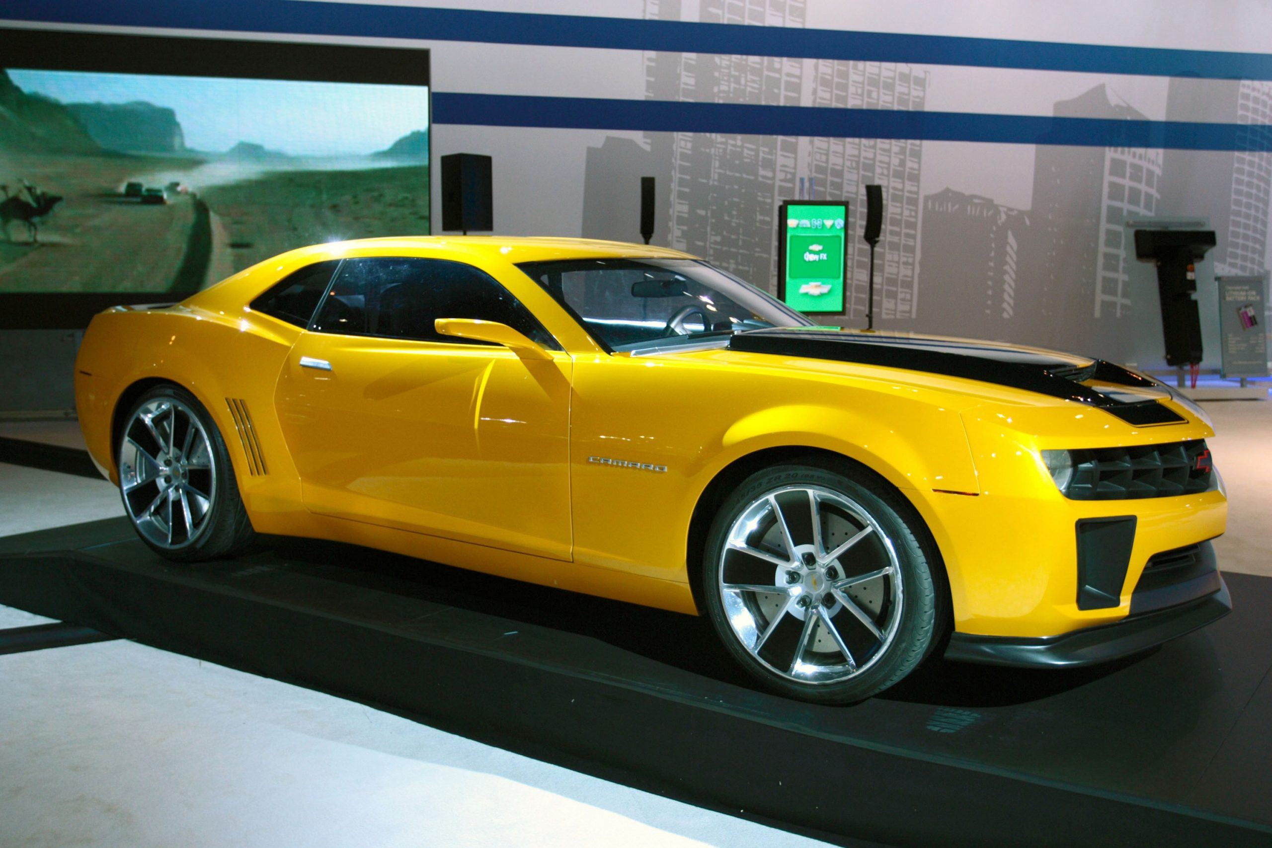 A yellow and black 2010 Camaro SS