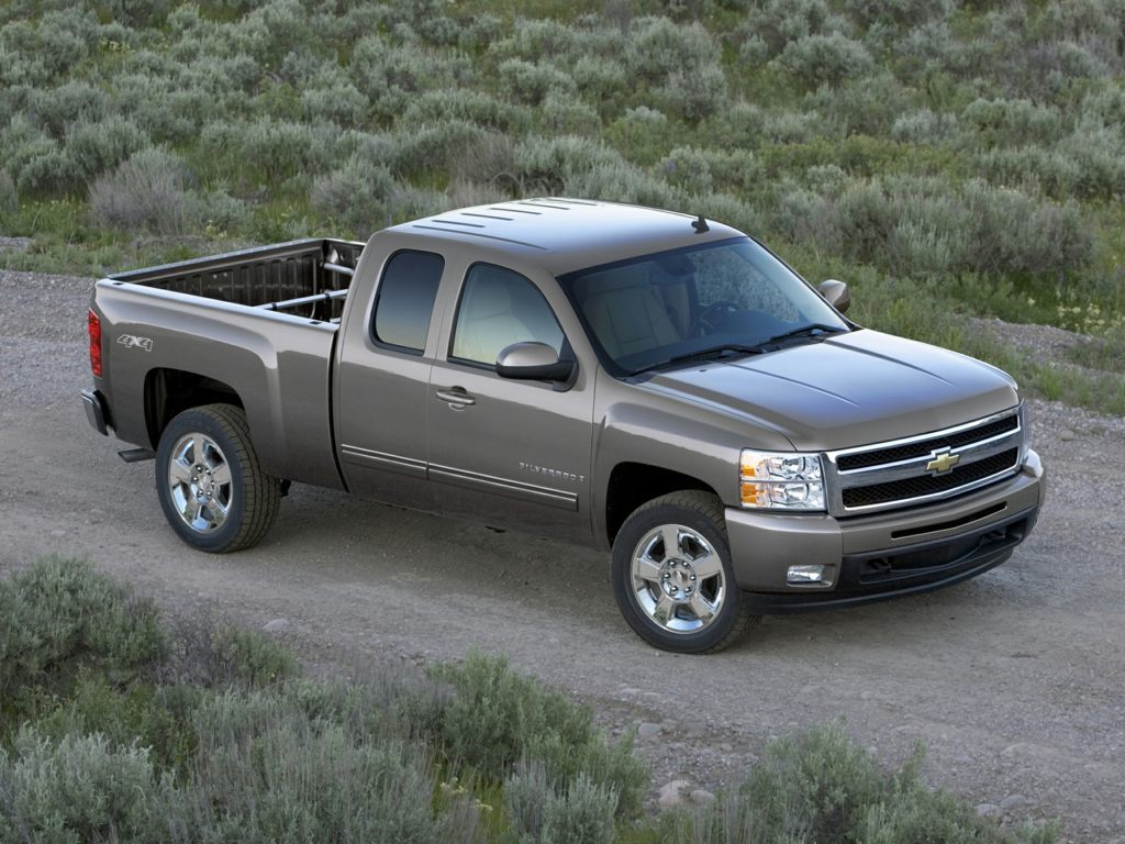 A gray 2012 Chevrolet Silverado 1500 parked on farm land somewhere